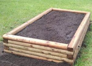 Wood raised garden bed example.